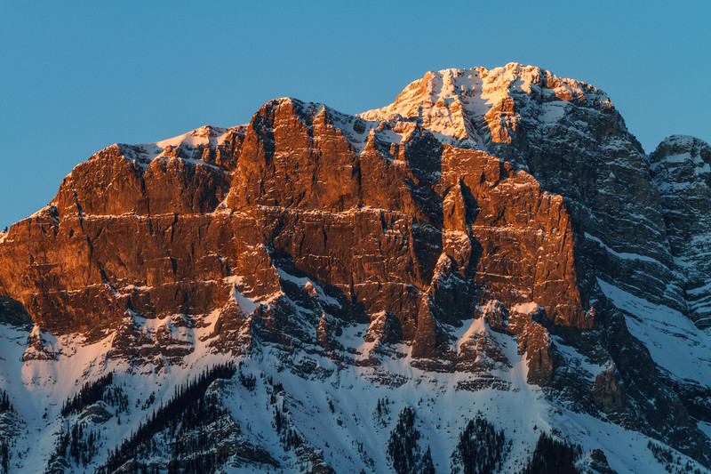 Sunset colors on icy Frozen peaks of the Canadian Rockies