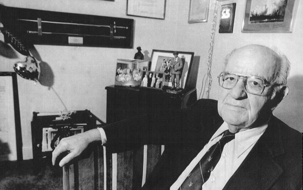 . Academy  Proponent --Joseph A. Reich sits among awards and memorabilia from the Air Force Academy at his home in Colorado Springs Thursday morning. Reich spear headed the effort to bring the Academy to the city in the late forties and early fifties. 1986. The Denver Post Library Archive