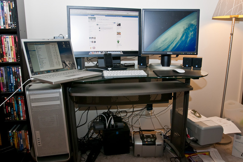 "My desk, with my newest addition: a quad-core 2.4 GHz Mac Pro with 6gb of RAM and a Dell U2410 24"" monitor. I've also hooked up my old Dell FP2100 20"" monitor. Also depicted is my 15"" Mac Book Pro (2.16 Ghz Core Duo) and my iPhone 4! Can you say ""Apple Fan""?! I can :)"
