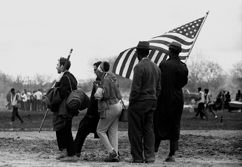 Men and woman preparing to march with American flag  Selma to Montgomery, Alabama Civil Rights March; March 23-25, 1965