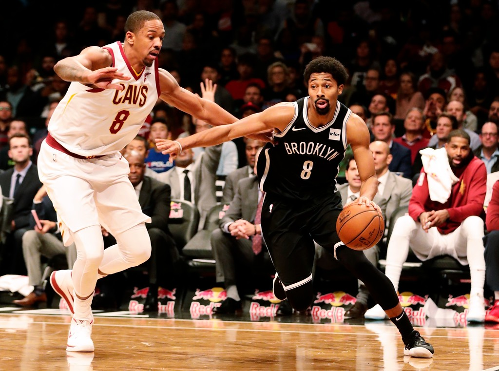 . Brooklyn Nets\' Spencer Dinwiddie (8) drives past Cleveland Cavaliers\' Channing Frye (8) during the second half of an NBA basketball game Wednesday, Oct. 25, 2017, in New York. The Nets won 112-107. (AP Photo/Frank Franklin II)