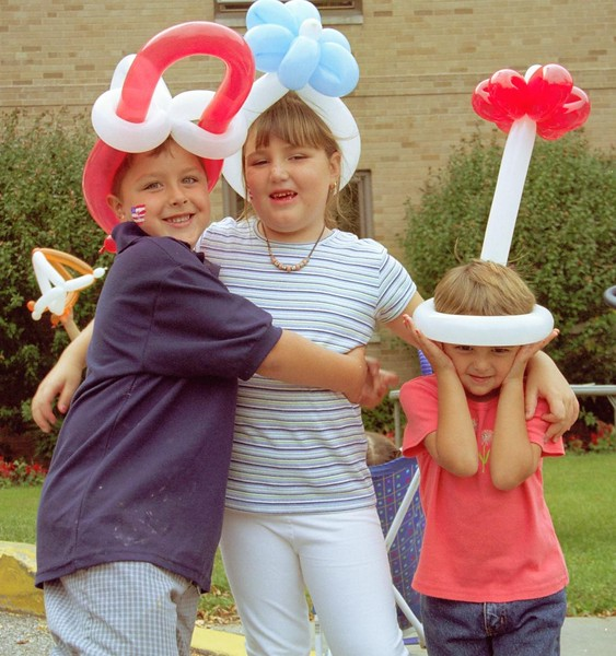 3 kids with baloons.jpg