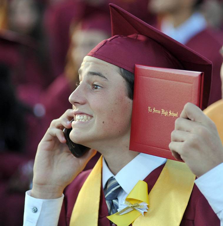 . Michael Iezza smiles with his diploma as his mother takes a picture from the stands during La Serna High School\'s 51st Annual Commencement at La Mirada High School stadium in La Mirada on Thursday June 13, 2013. La Serna marked the commencement of 635 graduates and marking Principal Ann Fitzgerald\'s first graduation as principal. (SGVN/Staff Photo by Keith Durflinger)