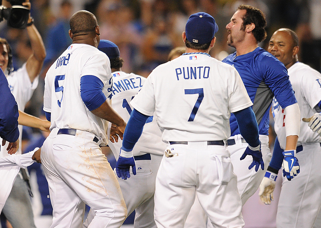 . Scott Van Slyke, right, had his jersey torn off by his team mates. The Dodgers defeated the Arizona Diamondbacks 5-3 after Van Slyke hit a 2 run walk off homer in the 11 inning at Dodger Stadium in Los Angeles, CA. 9/10/2013. photo by (John McCoy/Los Angeles Daily News)
