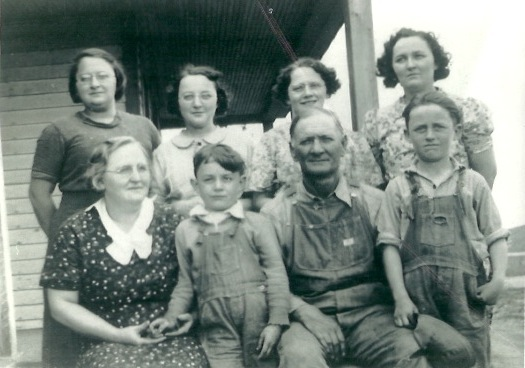 "Description of . Writes ANNE NONNY MOUSE: ""This is an old and treasured family photo that really speaks to me about that era. The little guy on there is my dad, John Perron, who is coming up on his 82nd birthday. Pictured also are his sisters, Rita Larson, Eileen Giles, Lorraine Quigley and Alice Auge, and his brother, Maurice Perron, and their parents, Adalor and Ellen Perron."""