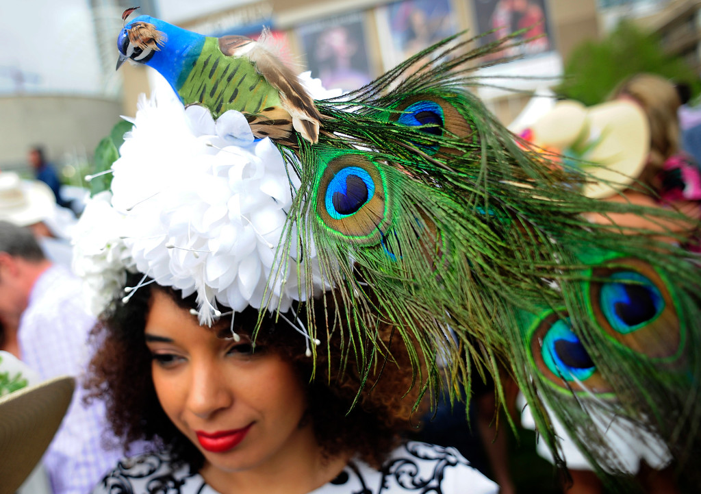 . Anika Abreu spots a peacock-themed hat during the Denver Derby Party at the Performing Arts Complex in Denver, Colorado, Saturday, May 7, 2016. The event featured The Macy\'s Best Hat Contest, and also awarded 3 full ride scholarships to students heading to Colorado State University. (Brenden Neville/Special to the Denver Post)