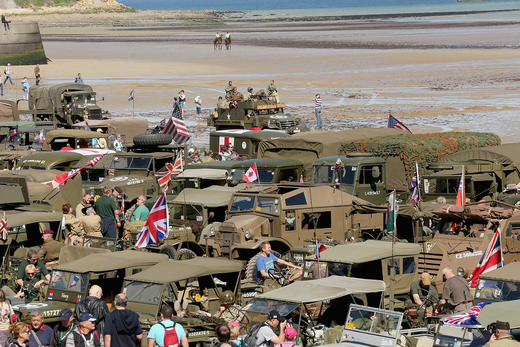 . WWII military vehicles and enthusiasts muster on Gold Beach at Arromanche to commemorate the 70th anniversary of the D-Day landings on June 6, 2014 in Arromanches Les Bains, France.   (Photo by Christopher Furlong/Getty Images)