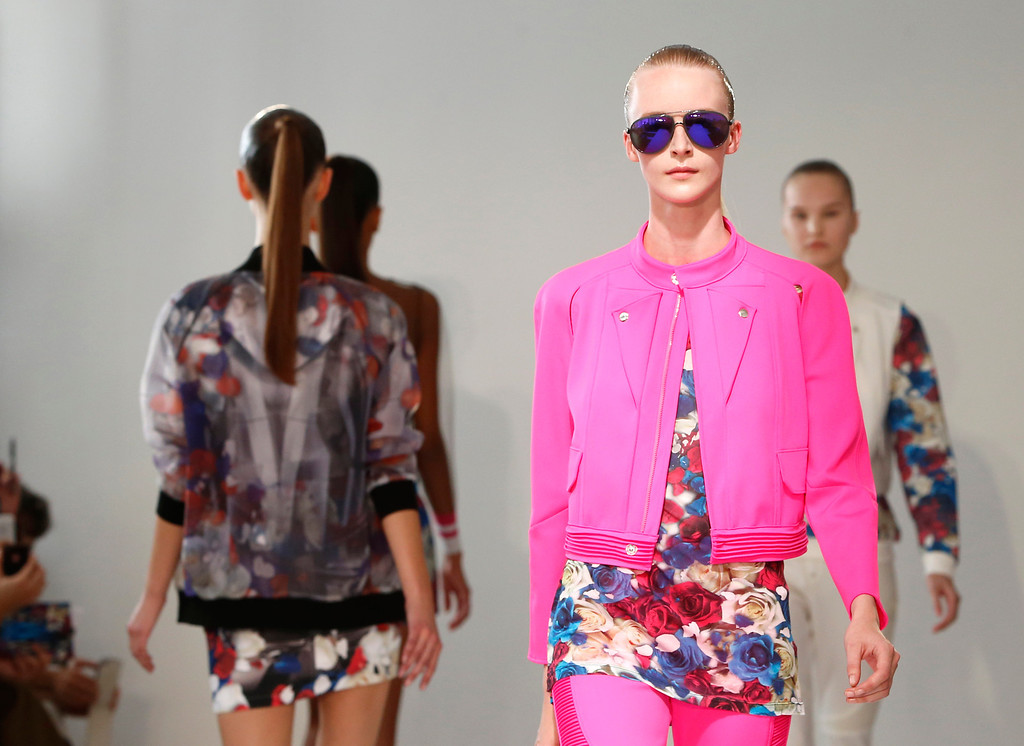 . Models present creations by fashion designers Eri and Philip Chu, from Hong Kong, for Ground Zero\'s ready-to-wear Spring/Summer 2014 fashion collection, presented in Paris, Tuesday, Sept.24, 2013. (AP Photo/Jacques Brinon)
