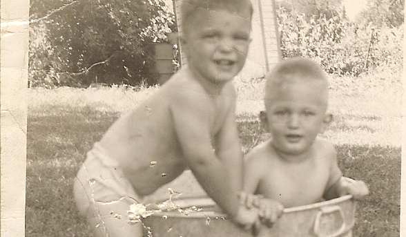 "Description of . The little treasures (Galvanized Tubs Division) Reports THE GENEALOGIST: ""Attached is a photo taken in 1946 of my twin brothers, Bob and Tod, taking a 'dip' in the galvanized pool. They were at the lake, so by nightfall it became a bathtub again. By the way, my brothers are turning 70 on August 1st. No way could they fit in that tub now."""