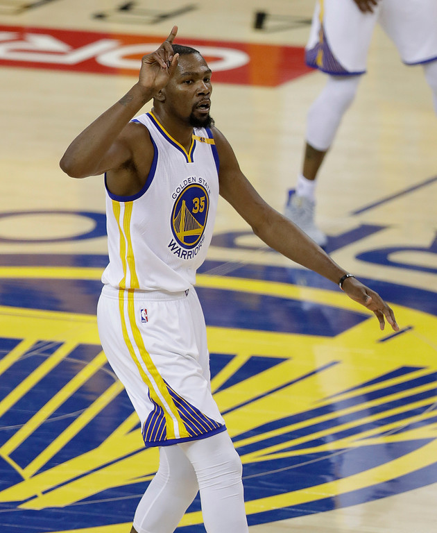. Golden State Warriors forward Kevin Durant (35) gestures after scoring against the Cleveland Cavaliers during the first half of Game 5 of basketball\'s NBA Finals in Oakland, Calif., Monday, June 12, 2017. (AP Photo/Marcio Jose Sanchez)