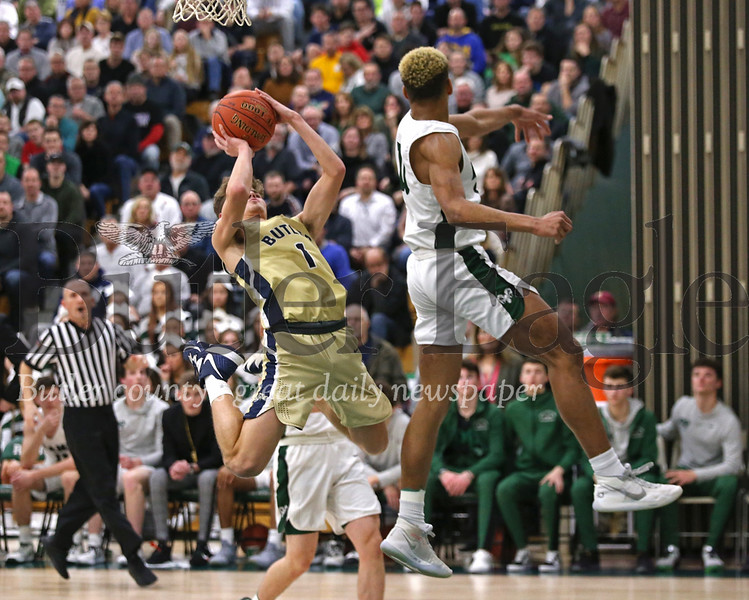 Butler's Raine Gratzmiller avoids a block from Pine Richland's Levi Wentz to get a shot off in the Golden Tornado's section clinching win Tuesday night. Seb Foltz/Butle Eagle