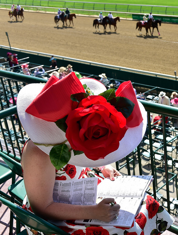 . A woman wearing a festive hat looks on prior to the 142nd running of the Kentucky Derby at Churchill Downs on May 07, 2016 in Louisville, Kentucky.  (Photo by Logan Riely/Getty Images)