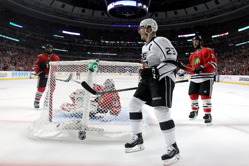 . Dustin Brown #23 celebrates after Corey Crawford #50 of the Chicago Blackhawks gave up a goal to Justin Williams #14 of the Los Angeles Kings in the first period during Game Seven of the Western Conference Final in the 2014 Stanley Cup Playoffs at United Center on June 1, 2014 in Chicago, Illinois.  (Photo by Jonathan Daniel/Getty Images)