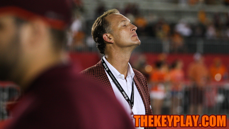 Virginia Tech athletic director Whit Babcock stretches his neck out as the Hokies go down big late in the game. (Mark Umansky/TheKeyPlay.com)