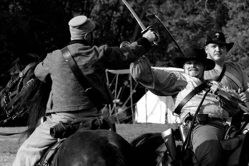 Confederate cavalry reenactors spar with swords during a demonstration at Patriots Point in Mt. Pleasant, South Carolina on Sunday, April 10, 2011. ..The 150th Anniversary of the Firing on Ft. Sumter was commemorated with lectures, performances, demonstrations, and a living history throughout the area on James Island, Charleston, Mt. Pleasant, and Sullivan's Island during the week from April 8-14, 2011. Photo Copyright 2011 Jason Barnette