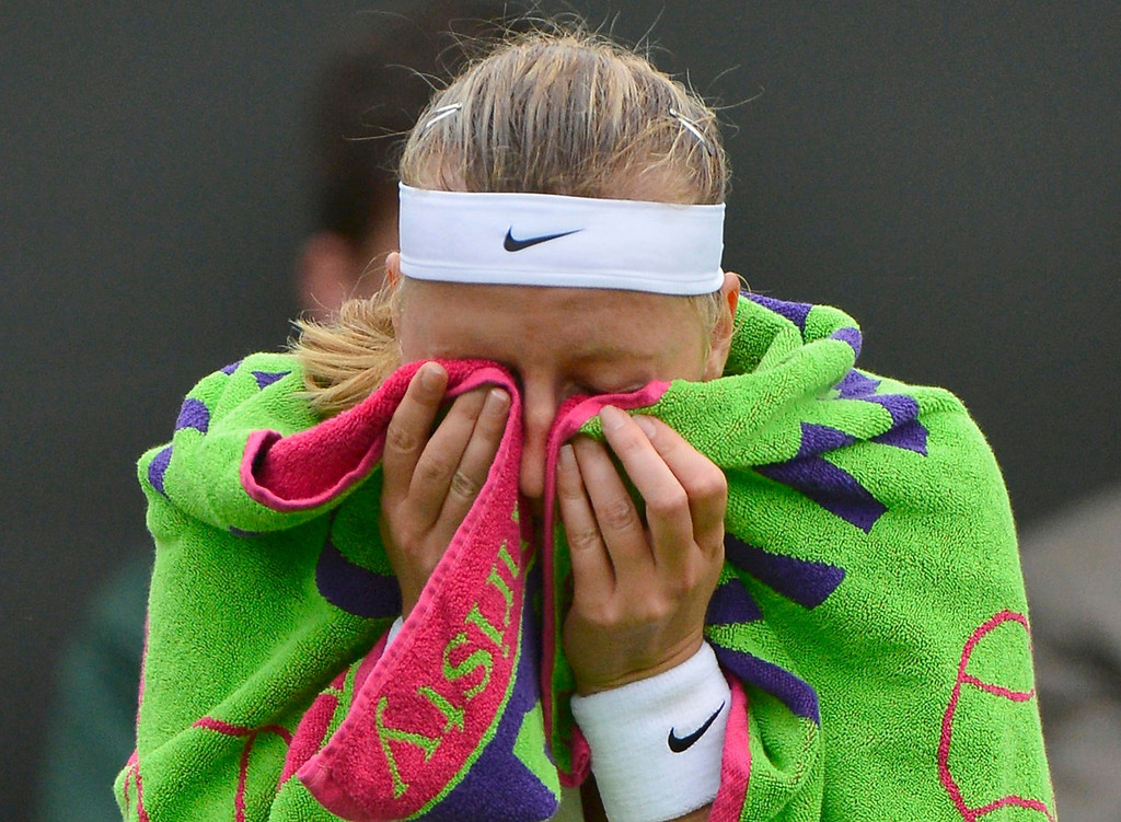 . Petra Kvitova of the Czech Republic wipes her face during her women\'s singles tennis match against Coco Vandeweghe of the U.S. at the Wimbledon Tennis Championships, in London June 24, 2013.  REUTERS/Toby Melville