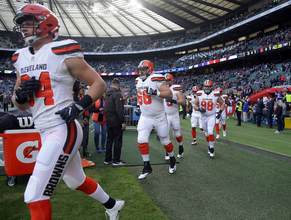 . Cleveland Browns guard Spencer Drango (66) runs onto the field with his teammates before an NFL football game against Minnesota Vikings at Twickenham Stadium in London, Sunday Oct. 29, 2017. (AP Photo/Matt Dunham)