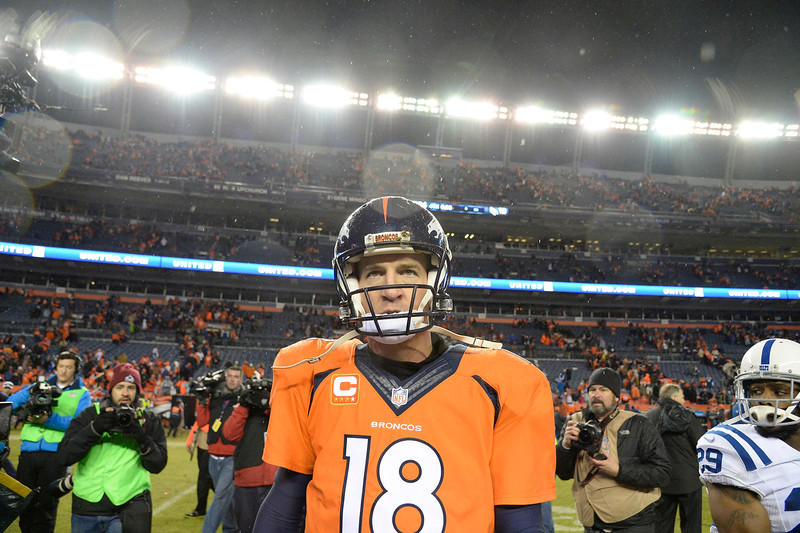 . Peyton Manning (18) of the Denver Broncos walks off the field after losing to the Colts. The Denver Broncos played the Indianapolis Colts in an AFC divisional playoff game at Sports Authority Field at Mile High in Denver on January 11, 2015. (Photo by AAron Ontiveroz/The Denver Post)