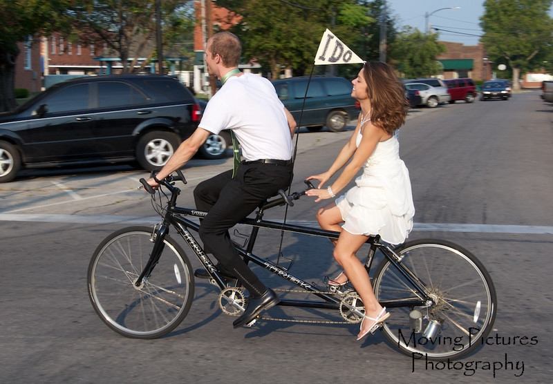 Erin & Matthew Wedding - the tandem ride from the church to the reception -> Yes, Erin rode in her wedding dress!