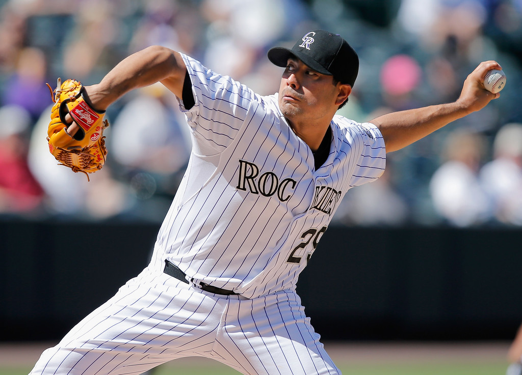 . DENVER, CO - SEPTEMBER 17:  Starting pitcher Jorge De La Rosa #29 of the Colorado Rockies delivers against the Los Angeles Dodgers at Coors Field on September 17, 2014 in Denver, Colorado.  (Photo by Doug Pensinger/Getty Images)