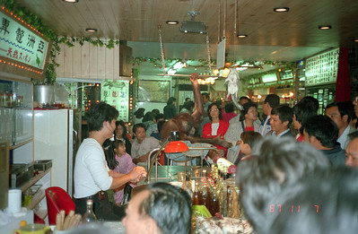 One of Barak Obama's relatives working the crowd in this Chinese restaurant in Taipei.