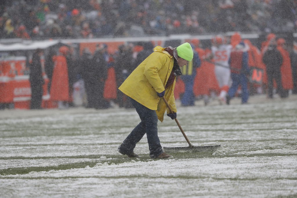 . A worker clears the field during an NFL football game between the Chicago Bears and Cleveland Browns in Chicago, Sunday, Dec. 24, 2017. (AP Photo/Nam Y. Huh)