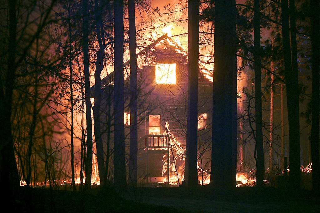 . A home east of Solon Springs, Wis., burns late Tuesday, May 14, 2013. Crews from Wisconsin and Minnesota were trying to control a rapidly growing wildfire in northwestern Wisconsin that forced evacuations of the sparsely populated area.  (Duluth News-Tribune: Clint Austin)