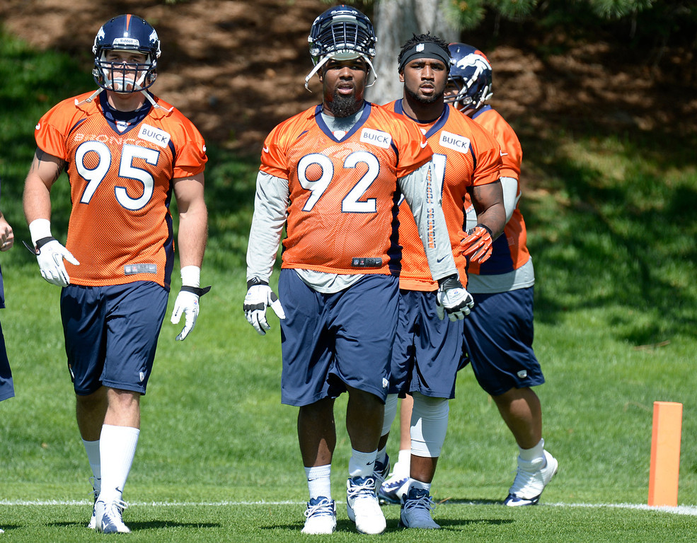 . Derek Wolfe (5) of the Denver Broncos and Sylvester Williams (92) head to the next station during the teams OTAs May 20, 2013 at Dove Valley. All offseason training activities (OTAs) are voluntary until the mandatory minicamp June 11-13. (Photo By John Leyba/The Denver Post)
