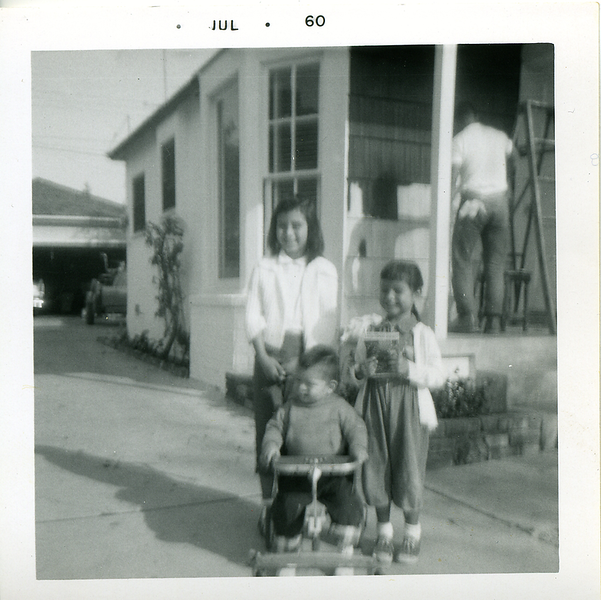 1960-07-kathie-mich-me-dad-still-on-porch.png