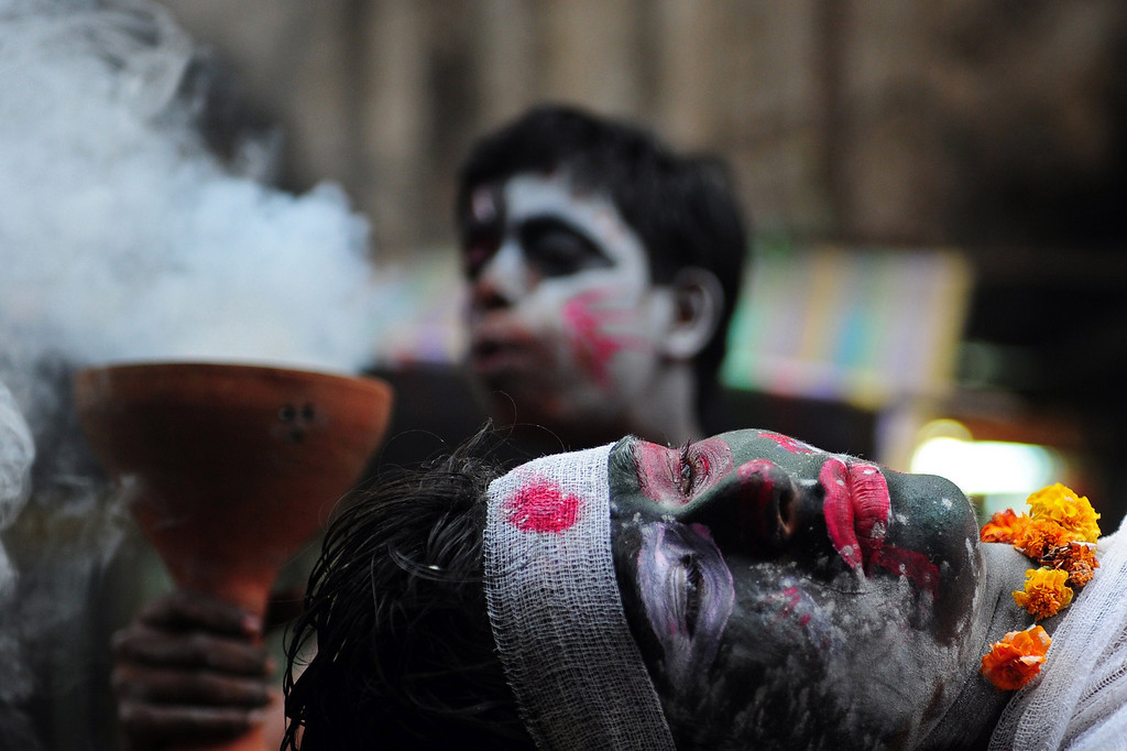 . Indian Hindu devotees perform a mock cremation ritual during a procession for Maha Shivaratri, dedicated to the Hindu god Lord Shiva, in Allahabad on February 27, 2014. AFP PHOTO/SANJAY Kanojia/AFP/Getty Images