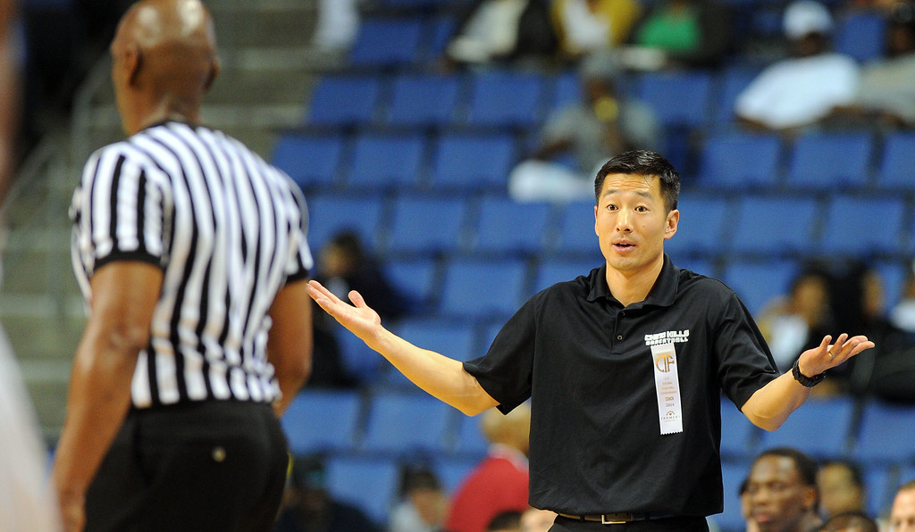 . Chino Hills coach Steve Baik questions a referee after receiving a bench technical foul at Citizens Business Bank Arena in Ontario, CA on Saturday, March 22, 2014. Chino Hills vs Centennial in the CIF boys Div 1 regional final. 2nd half. Centennial won 80-73 in overtime, Photo by Scott Varley, Daily Breeze)