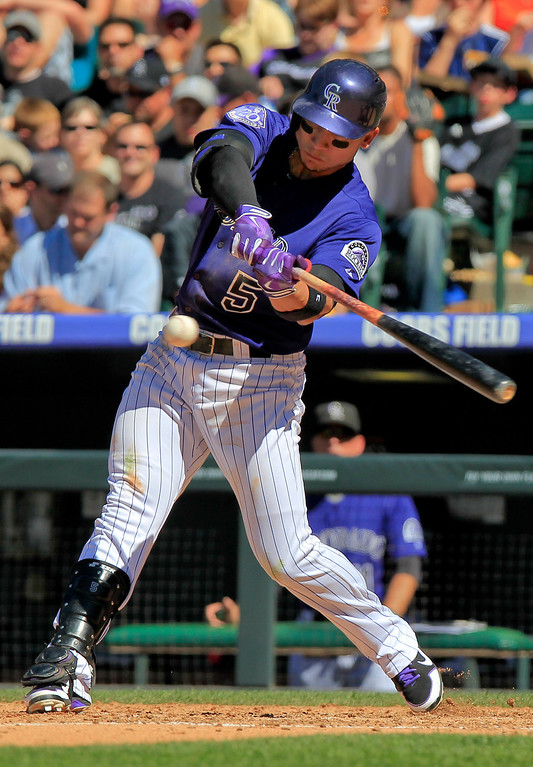 . Colorado Rockies\' Carlos Gonzalez (5) hits a two run home run to take a one run lead  over the Los Angeles Dodgers during the fifth inning of the MLB National League baseball game Saturday June 1, 2013 in Denver. (AP Photo/Barry Gutierrez)