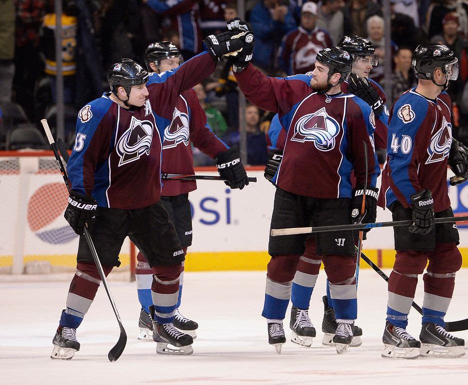 . DENVER, CO - JANUARY 21: Colorado Avalanche left wing Cody McLeod (55) high fives Colorado Avalanche center Ryan O\'Reilly (90) after their 3-2 victory in a shoot out over the Boston Bruins January 21, 2015 at Pepsi Center. (Photo By John Leyba/The Denver Post)