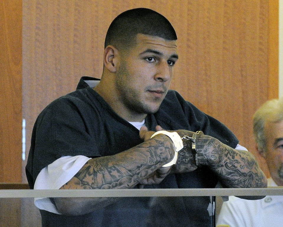 ". <p><b> Former New England tight end Aaron Hernandez, according to prosecutors, gunned down two strangers because � </b> <p> A. They bumped into him at a bar and spilled his drink <p> B. Disrespected him <p> C. Stabbing them to death would have taken too much energy <p><b><a href=\'http://www.twincities.com/vikings/ci_25849158/ex-patriots-player-due-court-2012-killings\' target=""_blank\"">LINK</a></b> <p>    (AP Photo/Boston Herald, Ted Fitzgerald)"