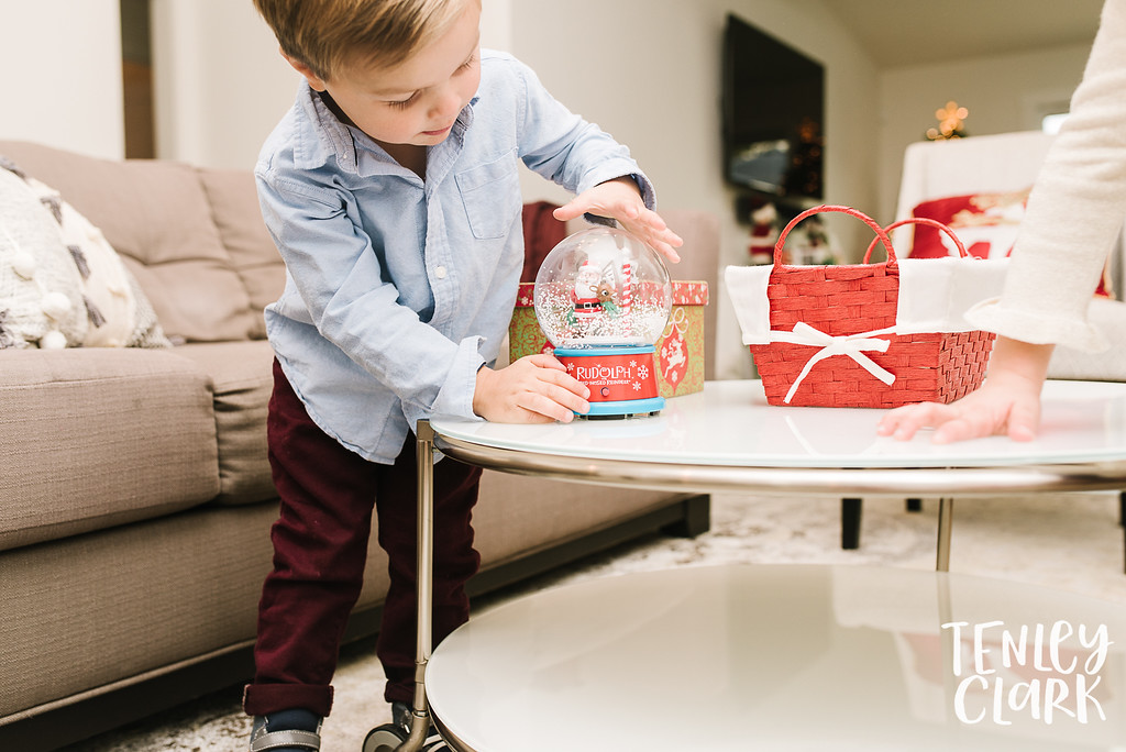 Little boy with holiday snow globe. Lifestyle in-home family photoshoot in Marin, CA by Tenley Clark Photography.