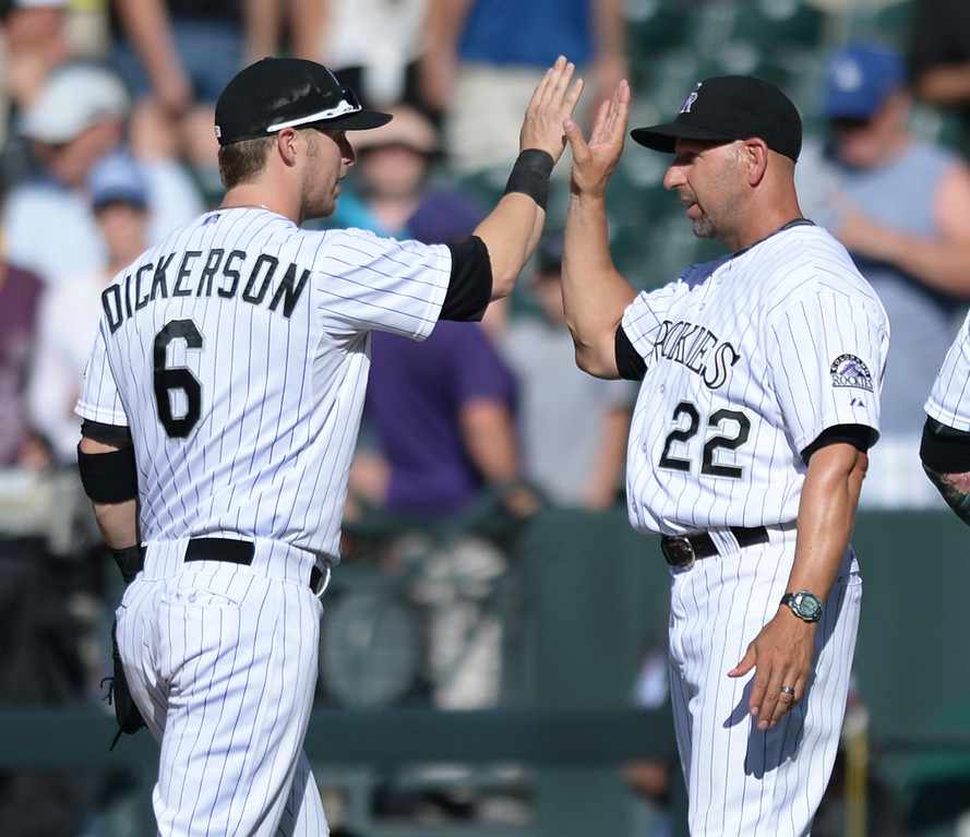 . DENVER, CO - JULY 5:  Corey Dickerson and Walt Weiss celebrated the win Saturday afternoon. The Colorado Rockies defeated the Los Angeles Dodgers 8-7 at Coors Field Saturday afternoon, July 5, 2014.  Photo by Karl Gehring/The Denver Post