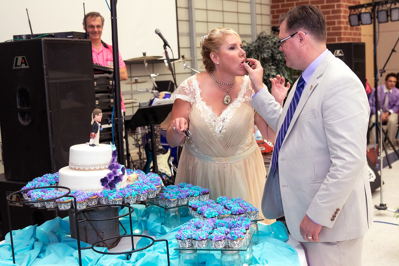 Groom feeding bride cake.jpg