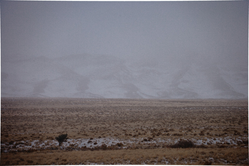 During a powerful winter storm with snow,  thunder and lightning as it engulfs the dunes in snow.