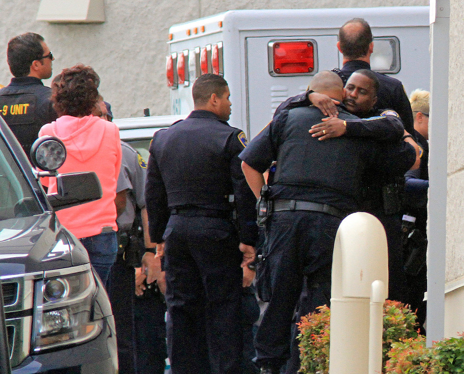 . Fellow law enforcement members gather at Eden Medical Center in Castro Valley, Calif., on Wednesday, July 22, 2015 where Hayward Police Sergeant Scott Lunger was transported after being shot during a traffic stop early Wednesday morning.  (Laura A. Oda/Bay Area News Group)