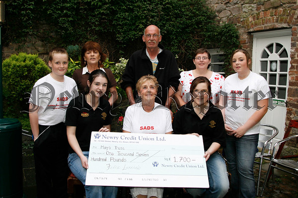 A total of £1,700 was raised in Felix Larkins Bar for Marys Trust, Shaunna & Rachel (staff) presented the cheque to Kathleen Mooney (fundraiser S.A.D.S.) with friends Denis Ward, Phil Heaney, Sara & Sean Mooney and Cathy Farrell, 07W35N55