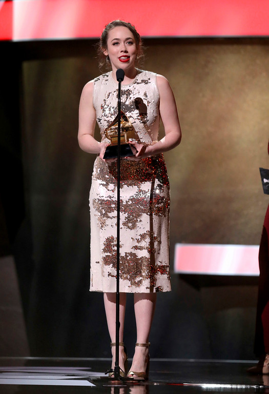 ". Sarah Jarosz accepts the award for best folk album for ""Undercurrent\"" at the 59th annual Grammy Awards on Sunday, Feb. 12, 2017, in Los Angeles. (Photo by Matt Sayles/Invision/AP)"