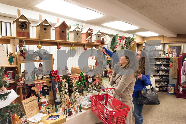 12/01/17 Wesley Bunnell | Staff The Berlin Historical Society Annual Holiday Fair opened Friday with an additional day Saturday from 9 a.m. to 4 p.m. Tammy Andersen, L, and Dawn Steimer have a yearly tradition of picking out one new ornament a year from the fair.