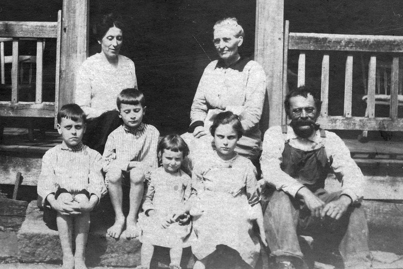 Family in front of JT Denbows House CU (c 1917).jpg