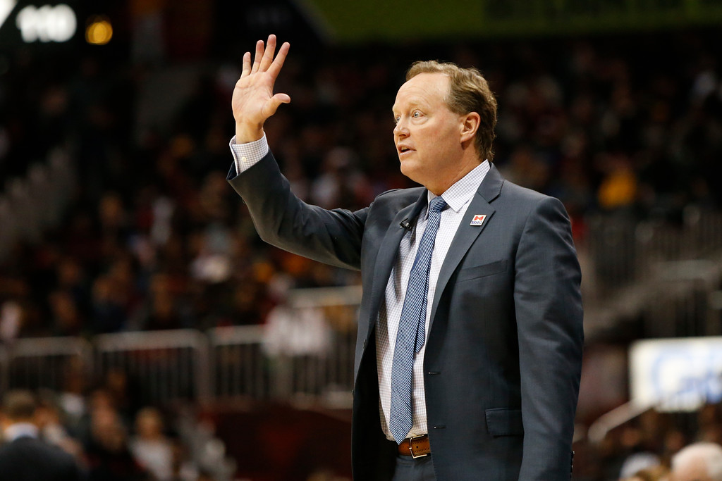 . Atlanta Hawks head coach Mike Budenholzer calls a play against the Cleveland Cavaliers in the second half of an NBA basketball game, Friday, March 3, 2017, in Atlanta.The Cavaliers won 135-130. (AP Photo/Brett Davis)
