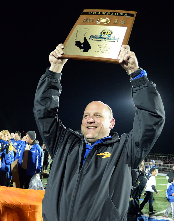 . San Dimas head coach Bill Zernickow holds-up the championship plaque after defeating Paraclete 20-14 a CIF-SS Mid-Valley Division championship football game at San Dimas High School in San Dimas, Calif., on Friday, Dec. 6, 2013.   (Keith Birmingham Pasadena Star-News)