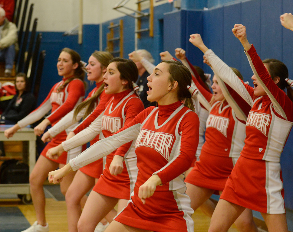 . Maribeth Joeright/MJoeright@News-Herald.com<p> The Mentor varsity cheerleaders twist and shout their team to victory over Glenville in the Division I district semifinal game at Euclid High School.