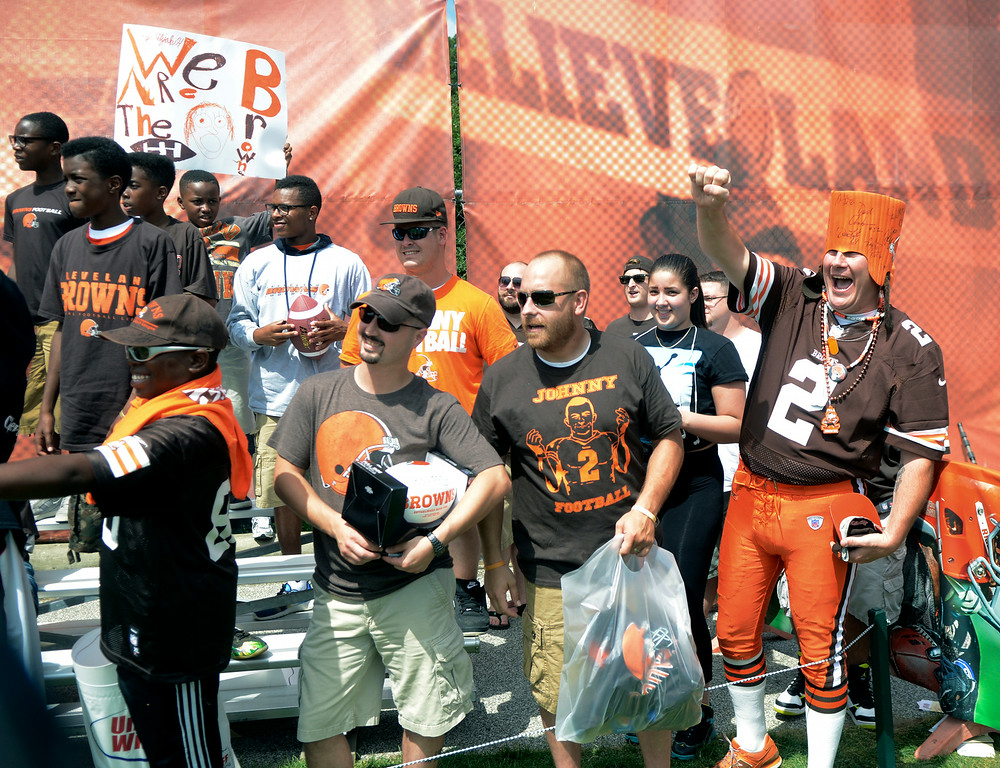 . Duncan Scott/DScott@News-Herald.com Fans cheer on their team as the Cleveland Browns opened training camp on July 26 with their first practice at Browns headquarters in Berea.