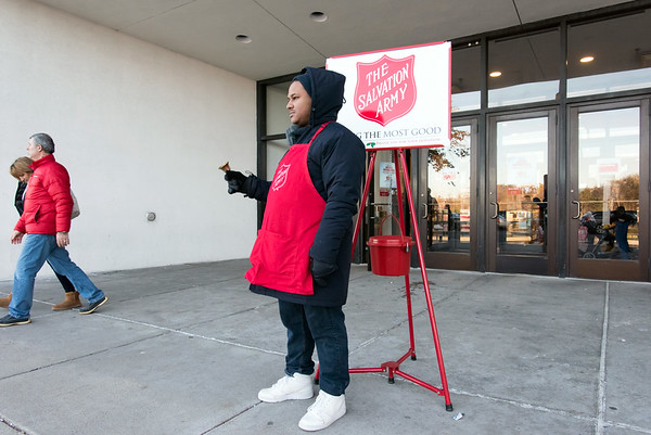 11/23/18 Wesley Bunnell | Staff Salvation Army volunteer Dalvin Lara rings the bell for donations outside of Macy's on Black Friday at the Westfarms Mall.