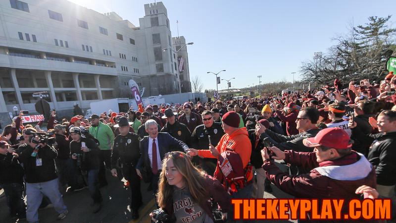 Head coach Frank Beamer shakes a fan's hand on the team walk to the locker rooms. (Mark Umansky/TheKeyPlay.com)