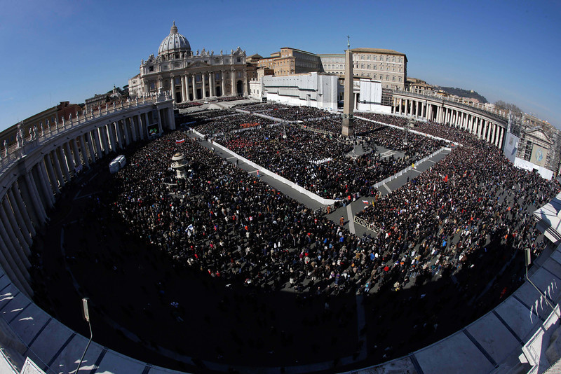 ". A view of the crowd in St. Peter\'s Square during Pope Benedict XVI\'s last general audience in St. Peter\'s Square, at the Vatican, Wednesday, Feb. 27, 2013. Benedict XVI basked in an emotional sendoff Wednesday at his final general audience in St. Peter\'s Square, recalling moments of ""joy and light\"" during his papacy but also times of great difficulty. He also thanked his flock for respecting his decision to retire. (AP Photo/Andrew Medichini)"